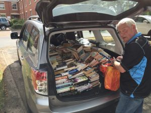 an open car boot full of books